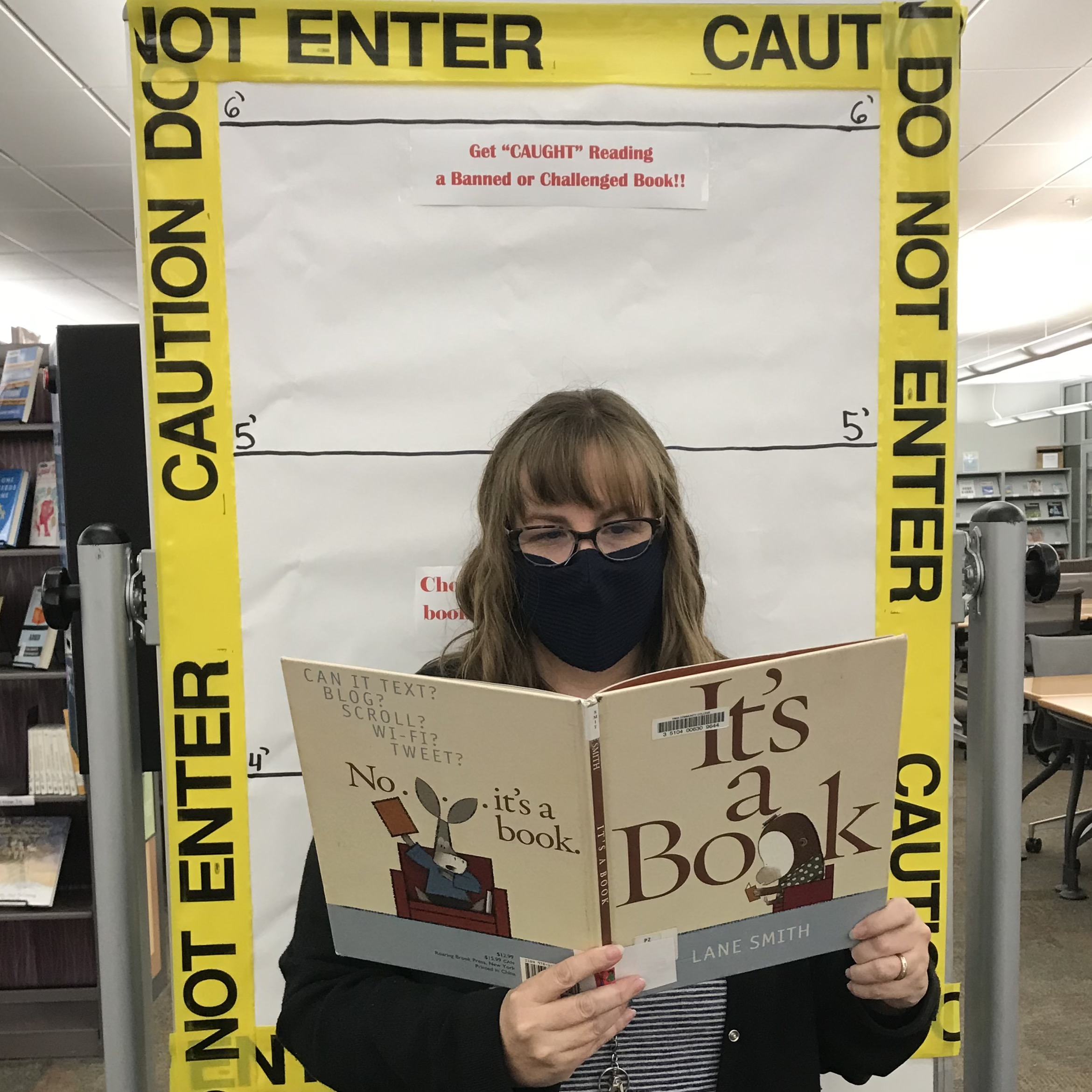 Image of employee with a banned book