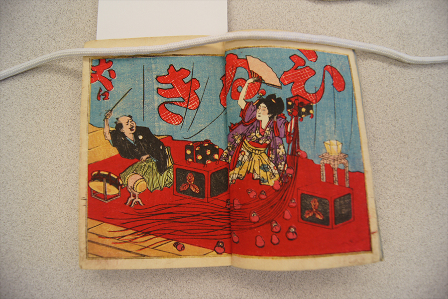 Image: An illustration of a magic performance, from Wayō tejina no tane