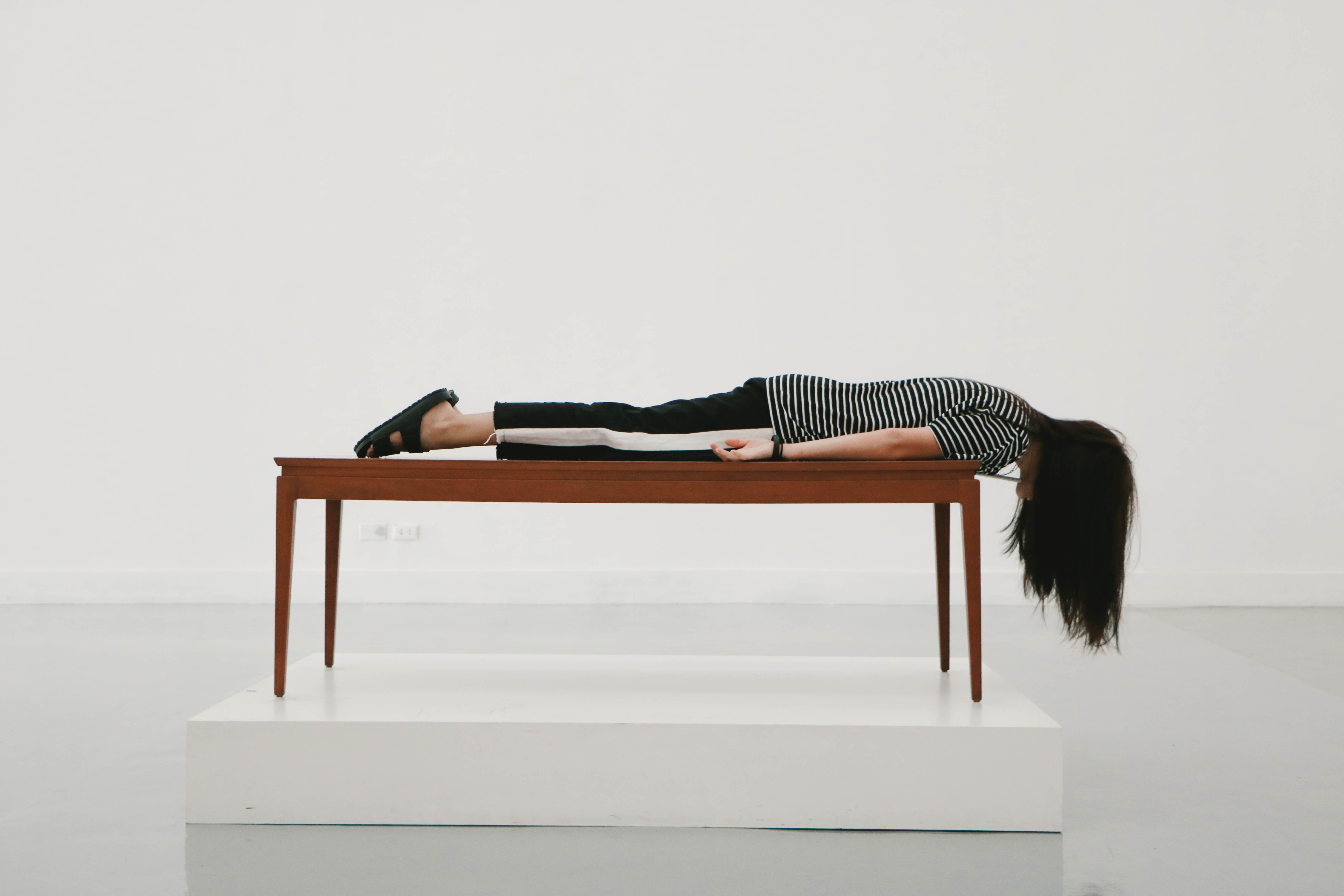 woman laying facedown on a table