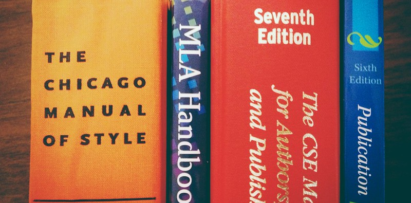 An image of the spines of several style handbooks (Chicago, MLA, CSE, APA)