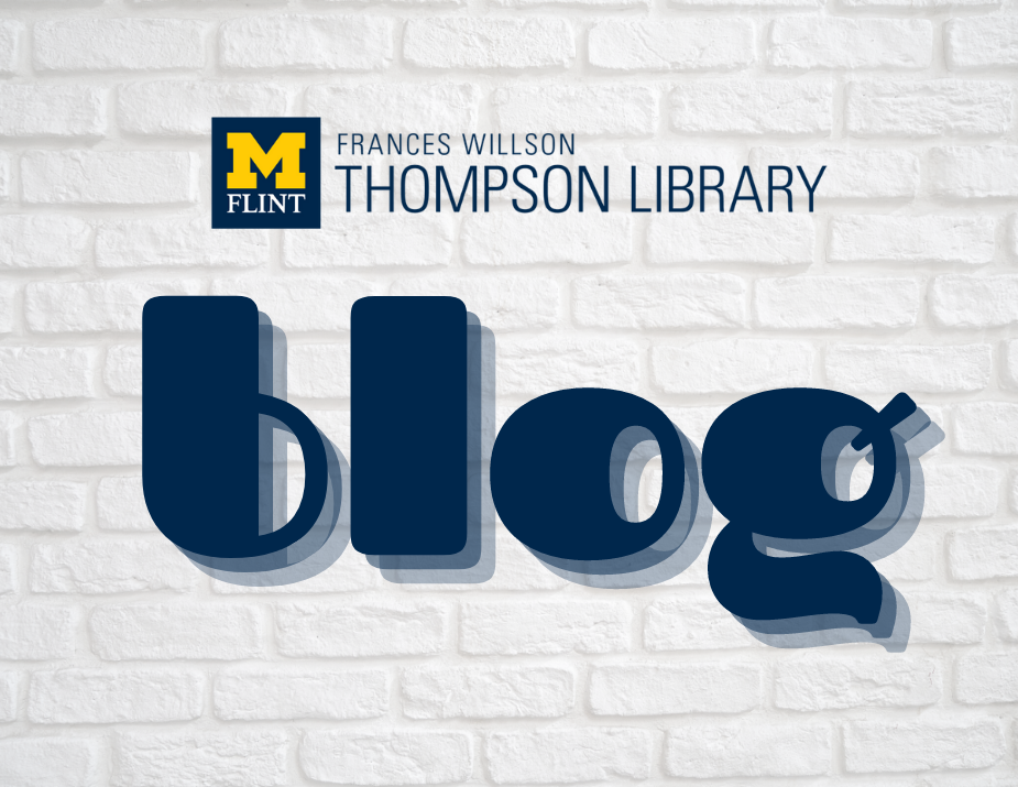 Thompson Library Blog in a retro font on a white brick background