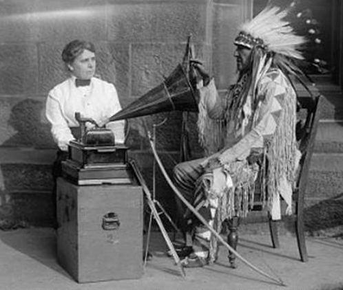 """Photograph of Frances Densmore and Mountain Chief (Blackfoot) during a 1916 phonograph recording session for the Bureau of American Ethnology"""