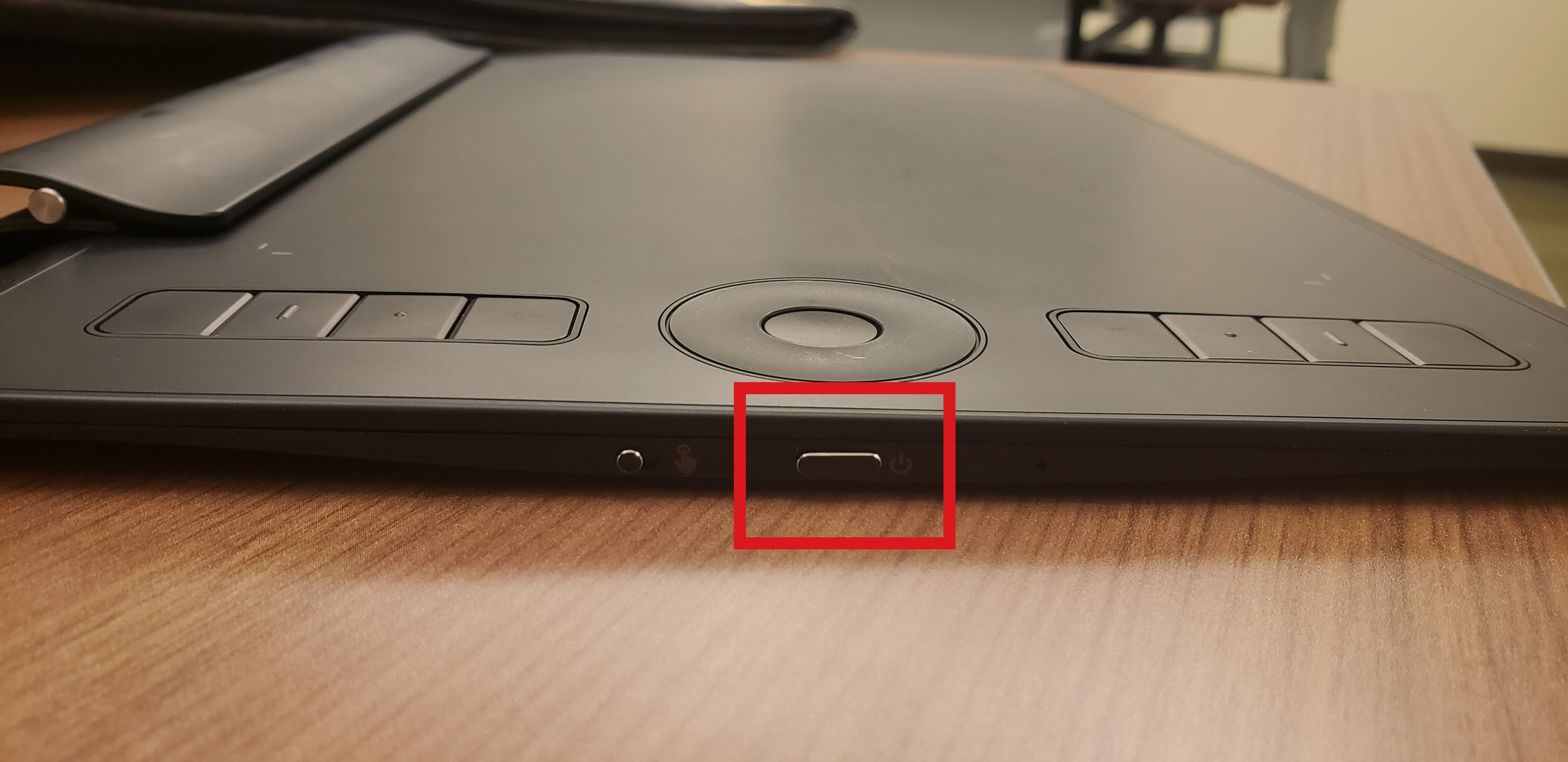 The power button on the left side in a red square