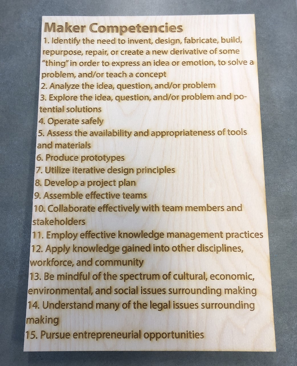 Maker Competencies Engraved on Wood