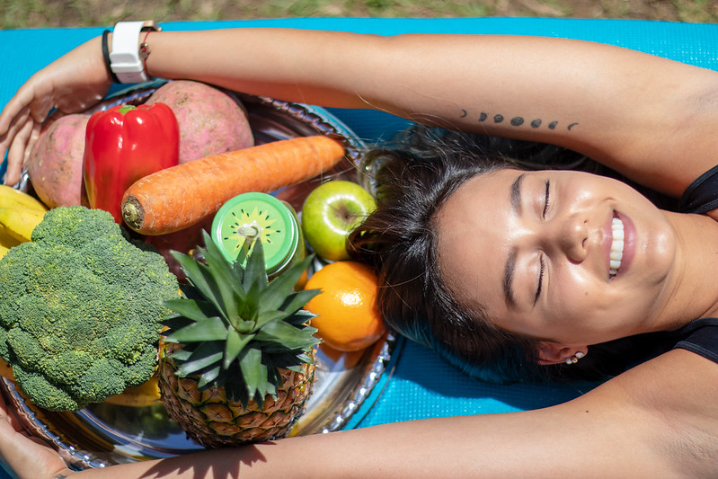 woman with platter of fruits and vegetables