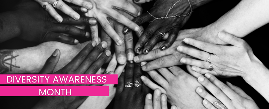 Black and white image of hands of different pigments with the text  Diversity Awarness Month
