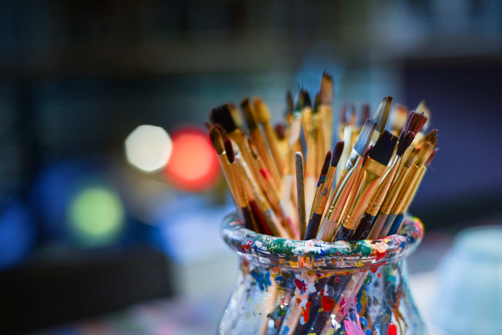 paint brushes up in cup