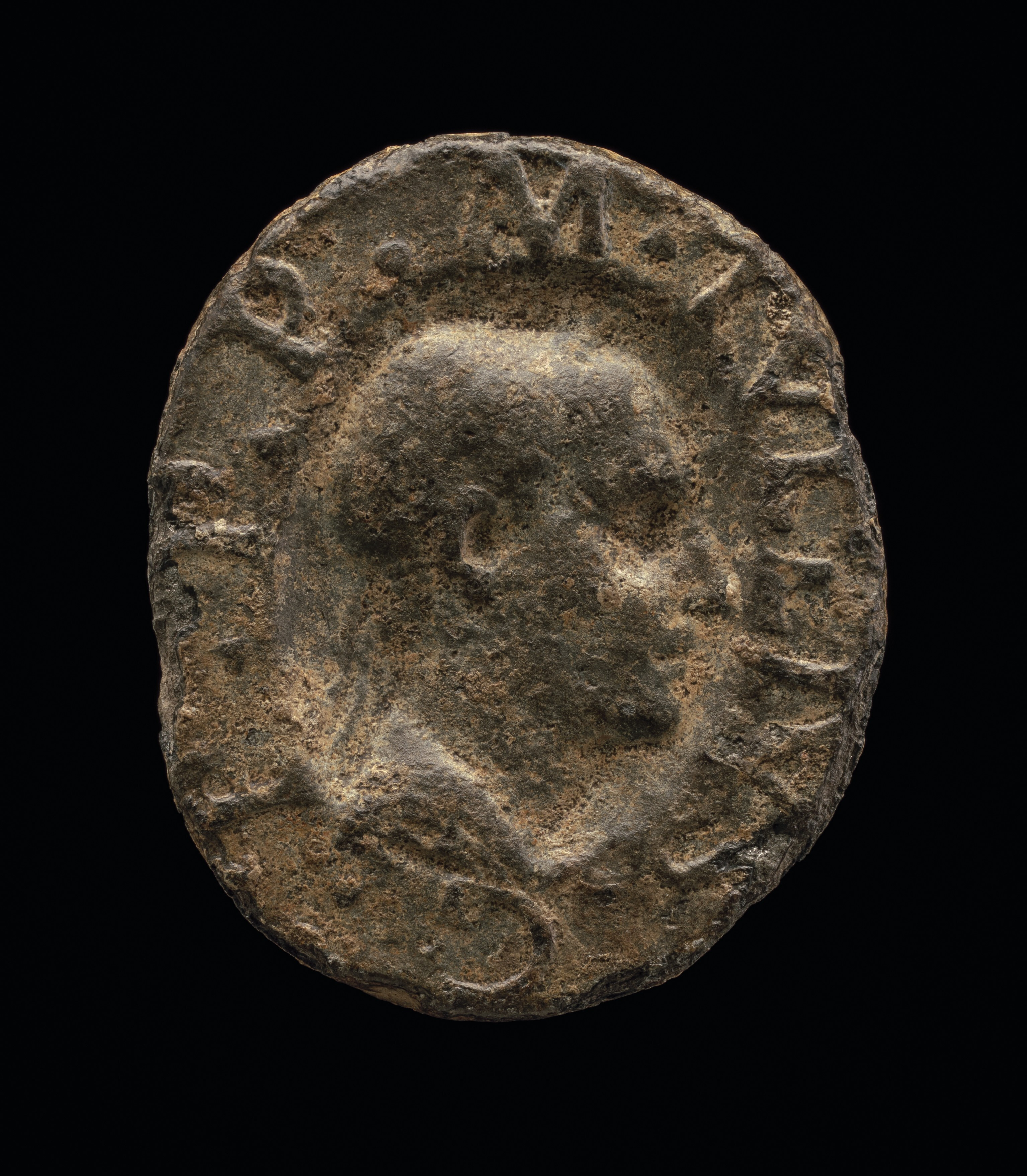 Pewter irregular oval with a head in profile in the middle; around circumference: M[ARCUS].TVLLIVS.C[ICERO].P[RIMUS].P[ATER].P[ATRIAE]. (Marcus Tullius Cicero, first father of his country)