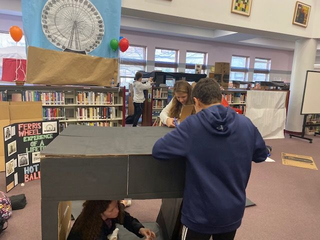 Picture of student working on project displays in library