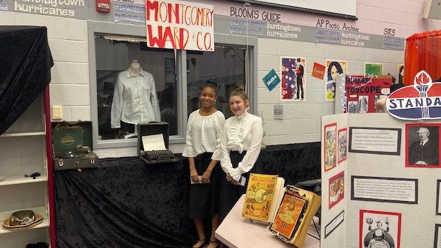 Picture of two students with their history project