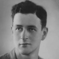 A black-and-white portrait of Carl Lavin as a young man