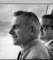 A black-and-white photograph of John Dolibois