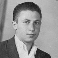 A black-and-white portrait of John Macsai as a young man
