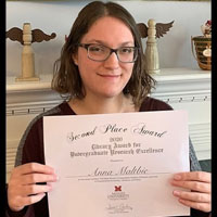Anna Maltbie poses with her second-place award certificate
