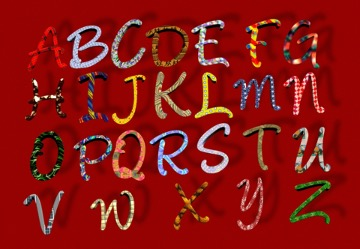 Image of the alpahbet in all capital letters with red background.