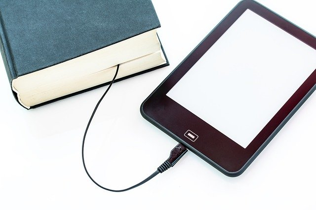 Print book with a wire portruding out of it to connect to a ereader device.