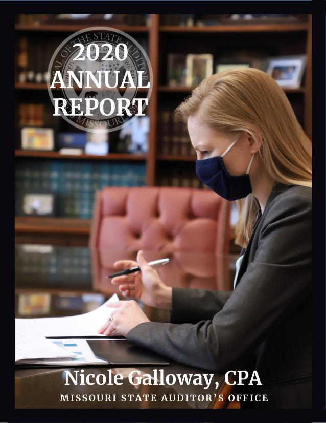 Image of State Auditor Nicole Galloway working at her desk, while wearing a mask