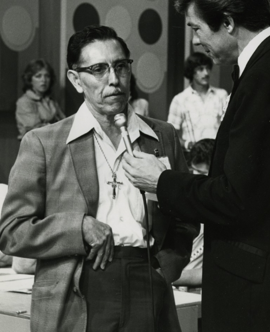 Image of Tim Flores speaking with an interviewer.