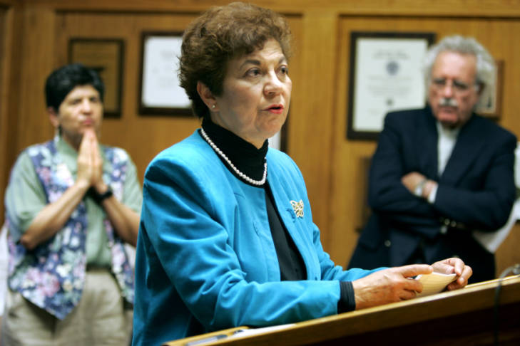 Former State Senator Polly Baca (center) of Denver leads a discussion during a press conference as community activist Rosella Gonzales (cq) (far left) of Denver and Rev. Bill Kirton (far right) of Cameron Methodist Church listen on.