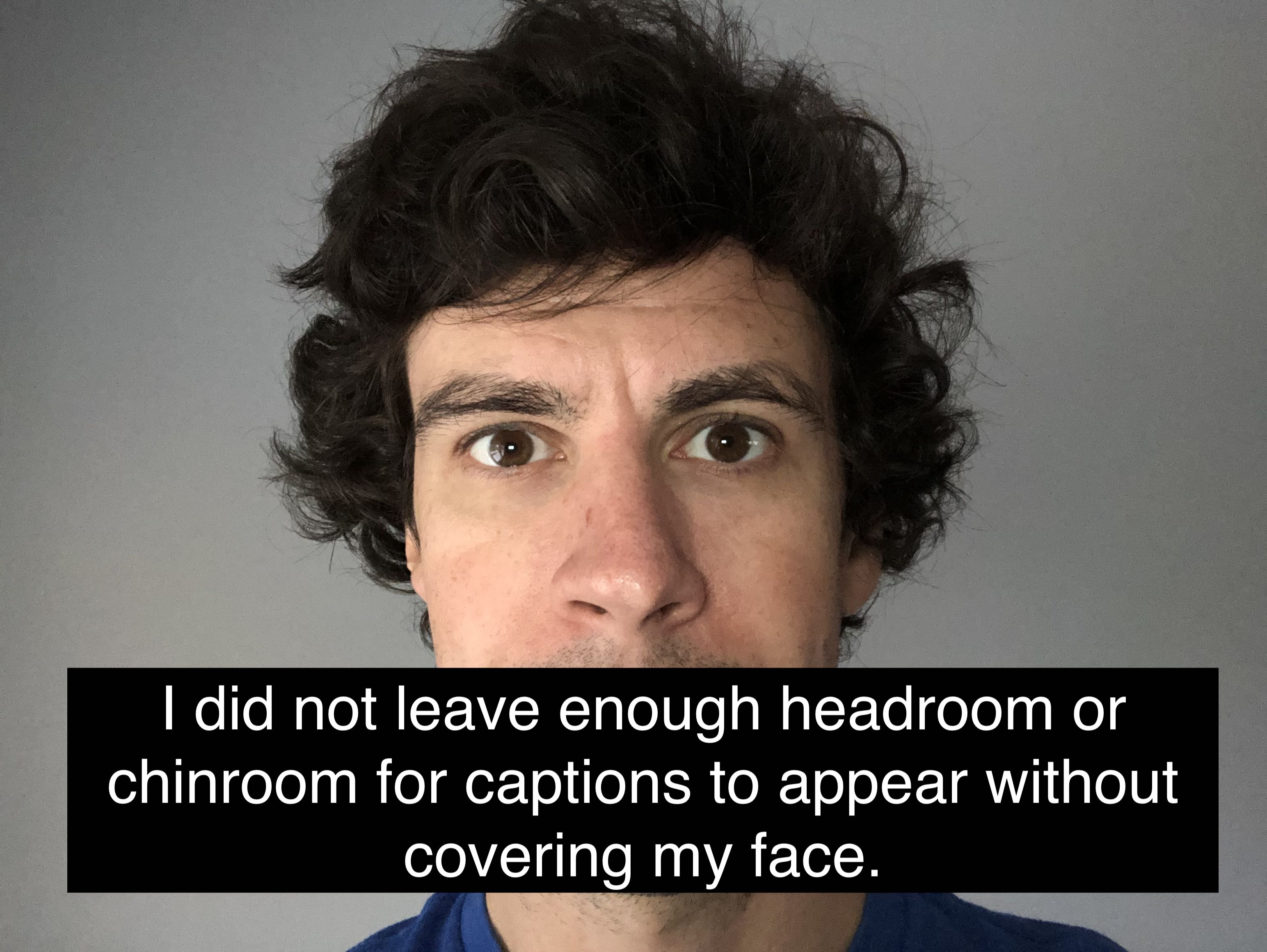 Photo of presenter in video where captions are covering lower part of subject's face.