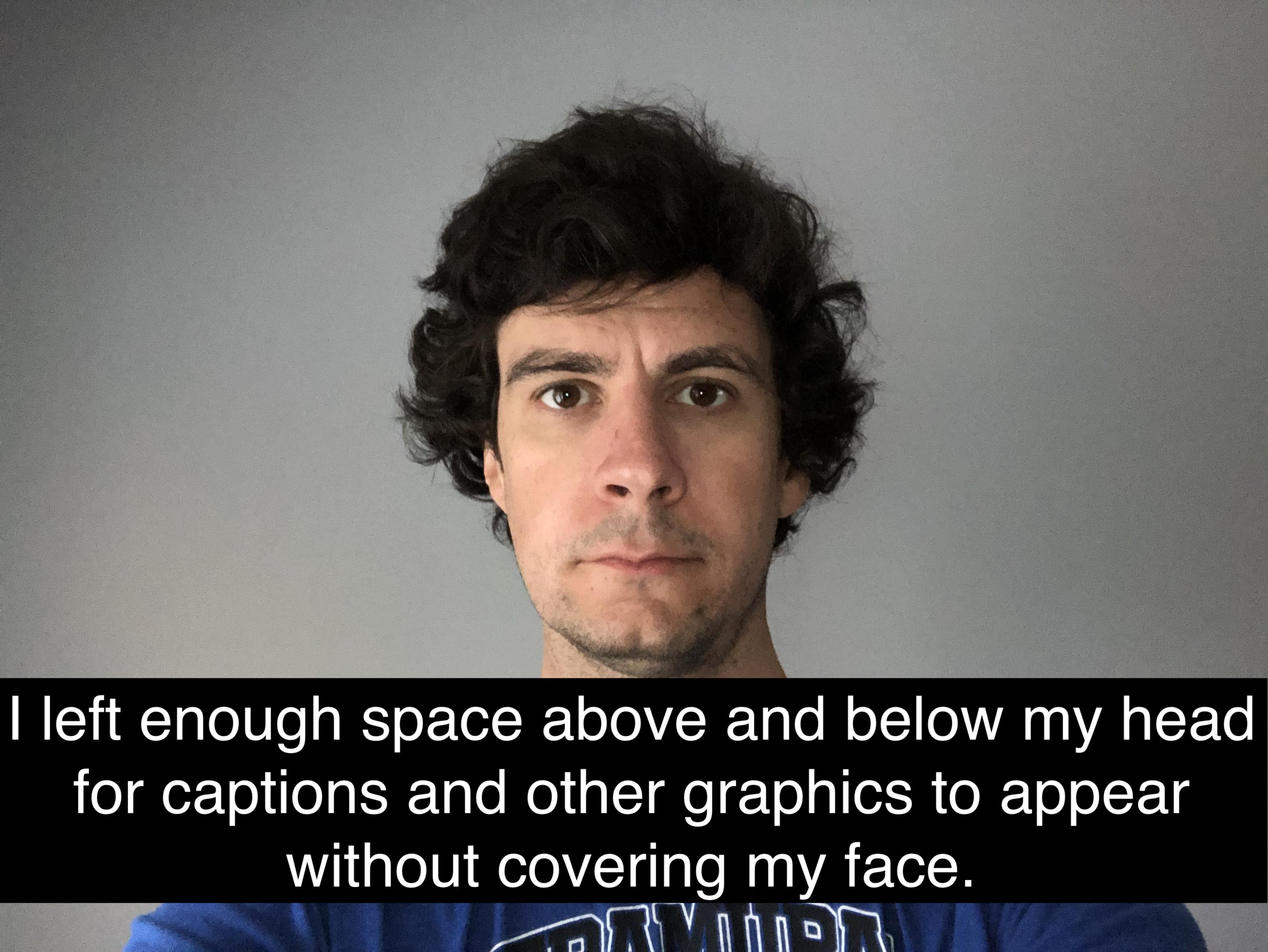 Presenter where video is composed to leave space for captions to appear below the subject's face.