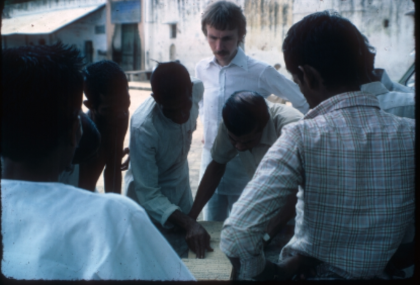 Entwistle looking at map with a group of men in India