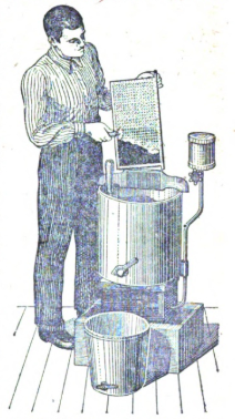 Man collecting honey into barrel and bucket.