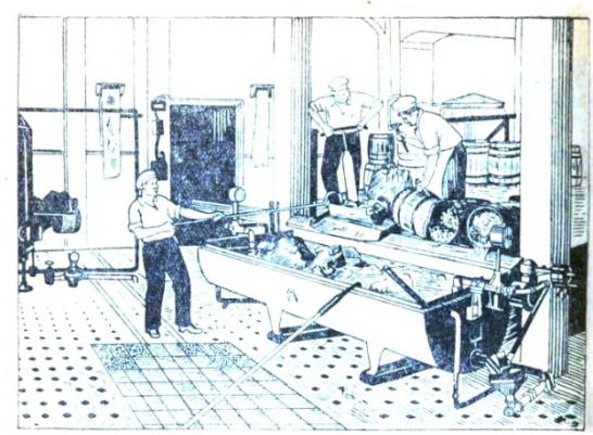 Men in a honey factory emptying barrels into a vat