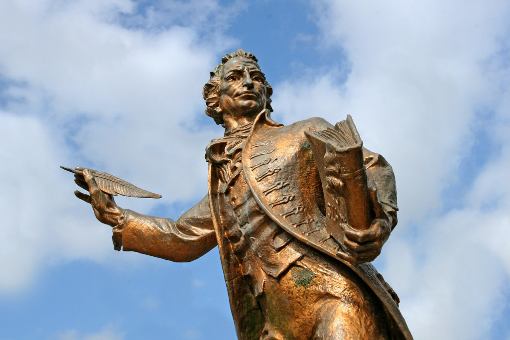 Thomas Paine statue holding book and quill