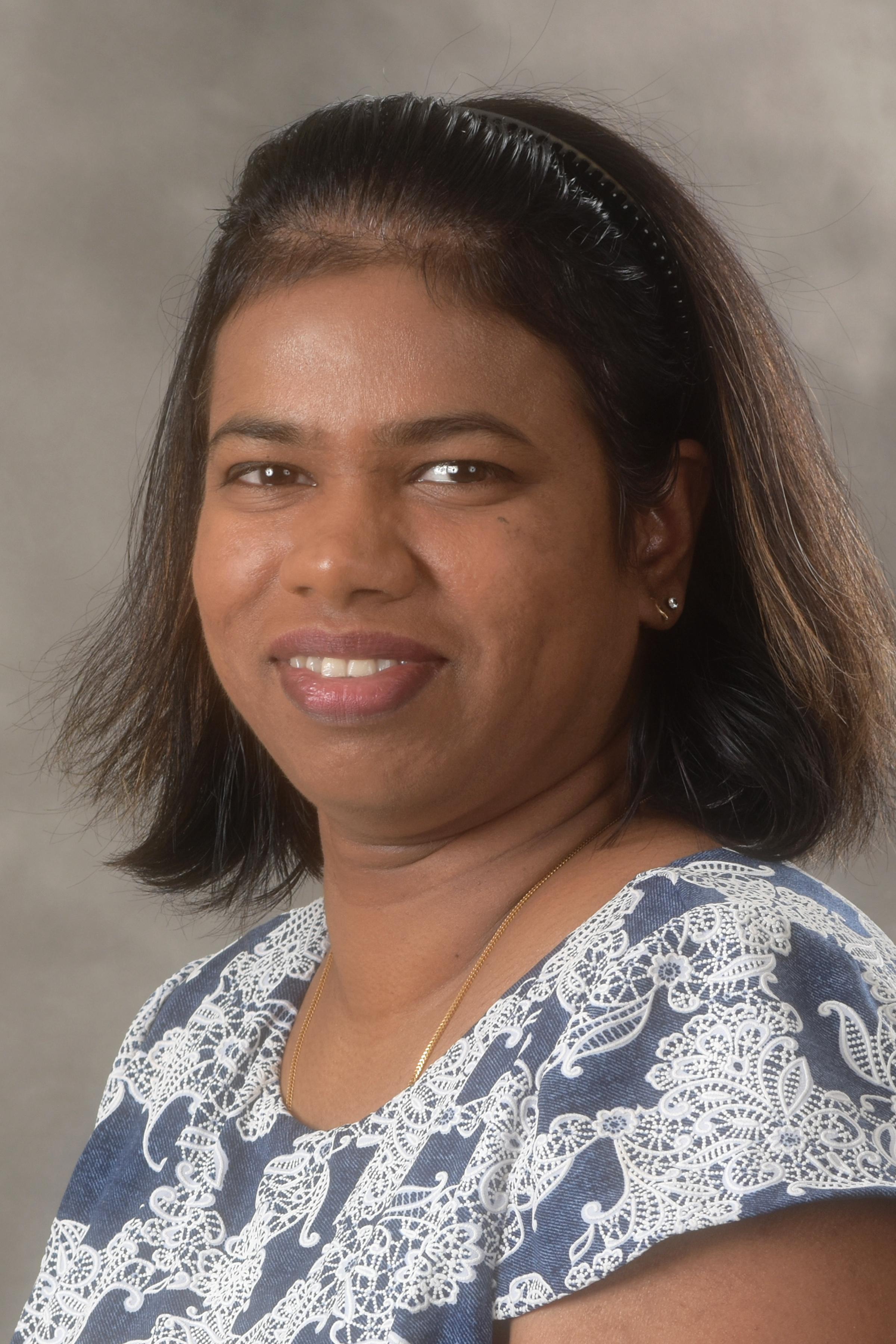 Headshot of Indu Rasika Churchill