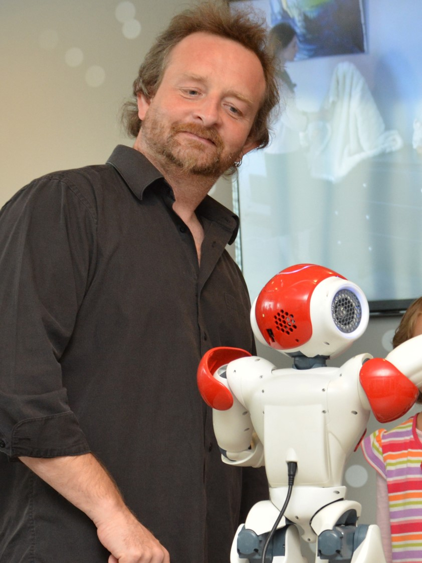 Damian Schofield with robot