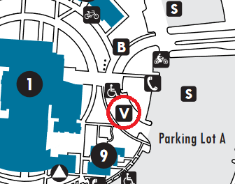 Detail of the FLC campus map. There is a red circle pointing to the visitor parking section, which is in the semicircle curve in Parking Lot A, in front of Building 1, near the flagpoles.