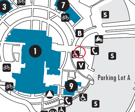 Detail of the FLC campus map. There is a red circle pointing to the book return location, which is at the center of the semicircle curve in Parking Lot A, in front of building 1, near the flagpoles.