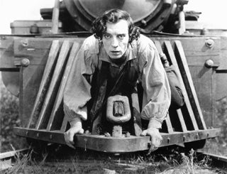 man sitting on the front of a train in a movie still