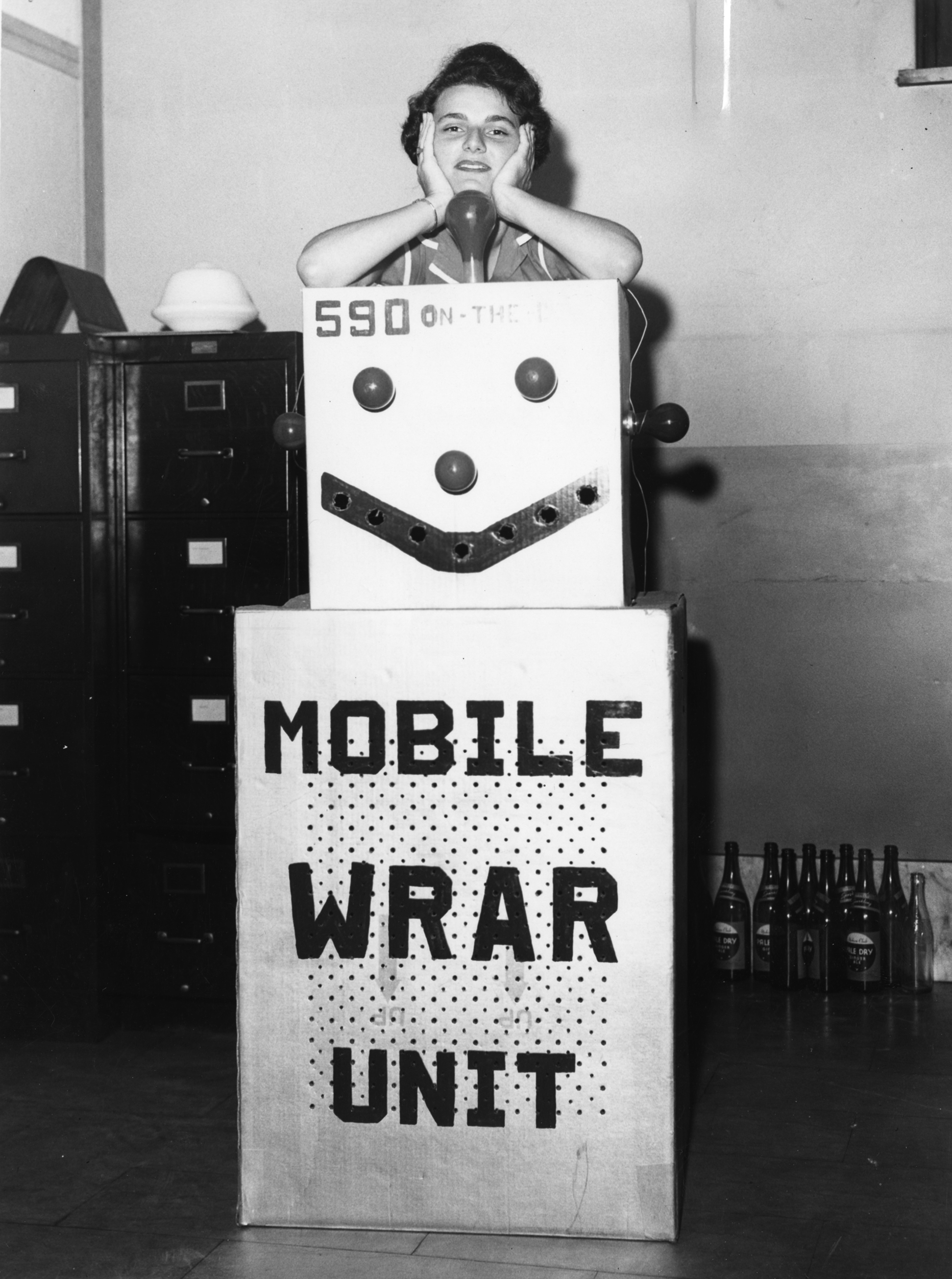 Martha Wagner with a WRAR radio transmitter decorated as a robot in 1957. in 1957.