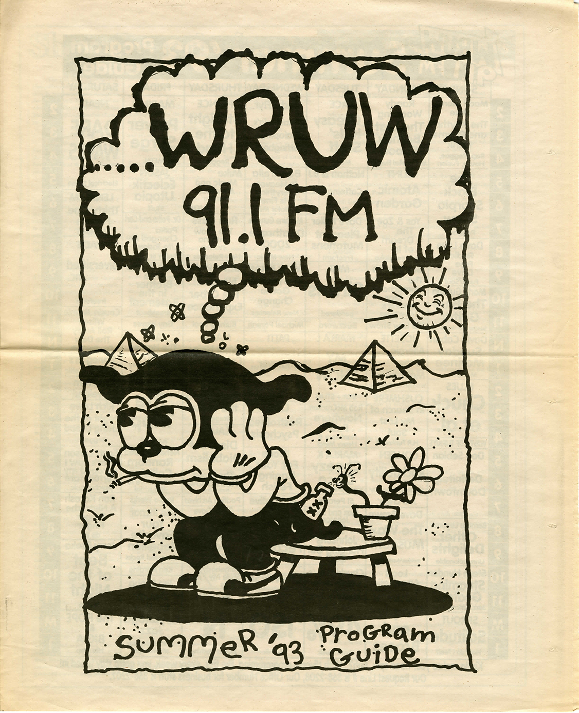 Newsprint cover of WRUW programming guide with image of cartoon dog in the desert from 1993.