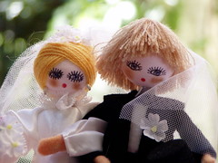 photo of two dolls in wedding outfits