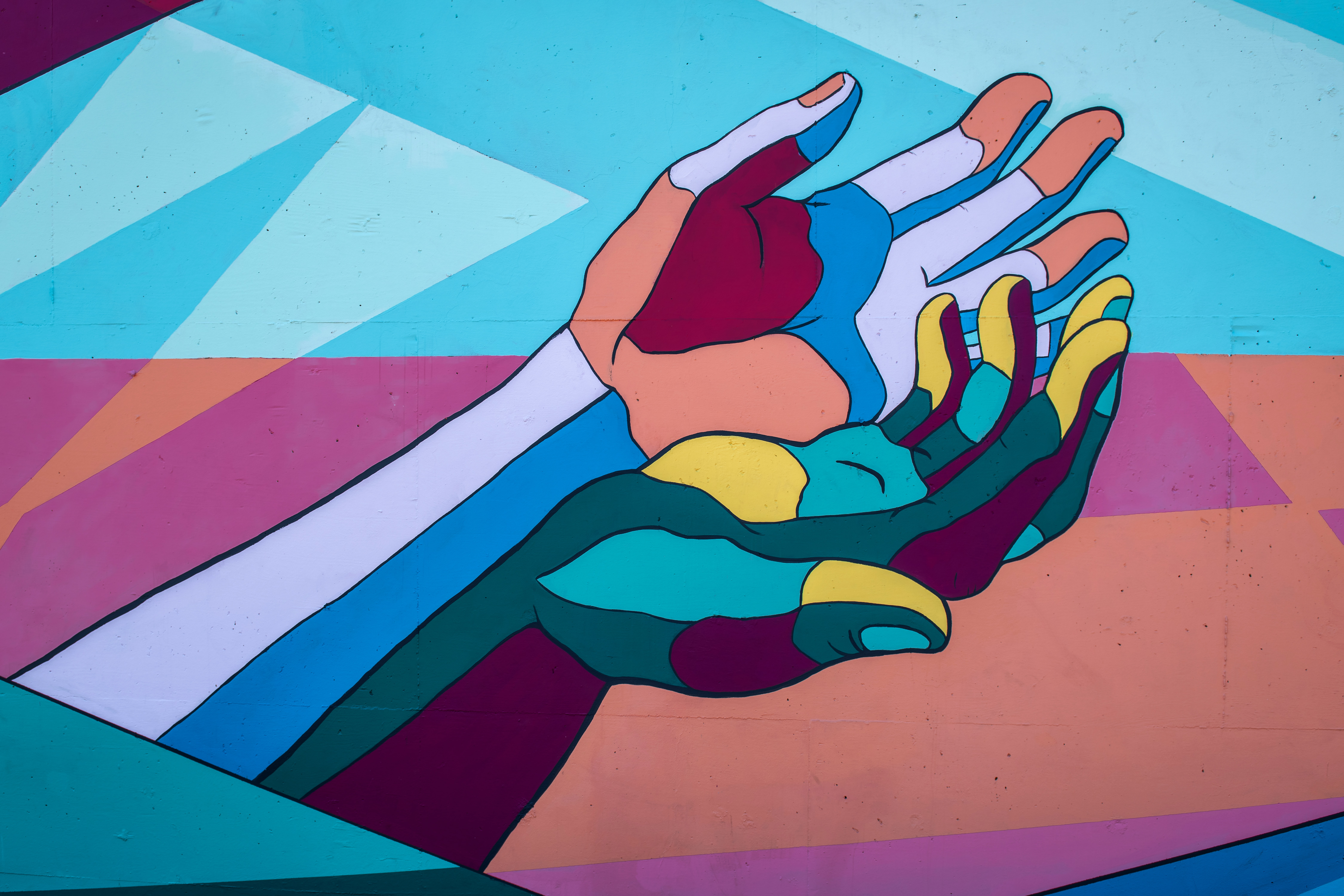 Mural depicting two colorful hands
