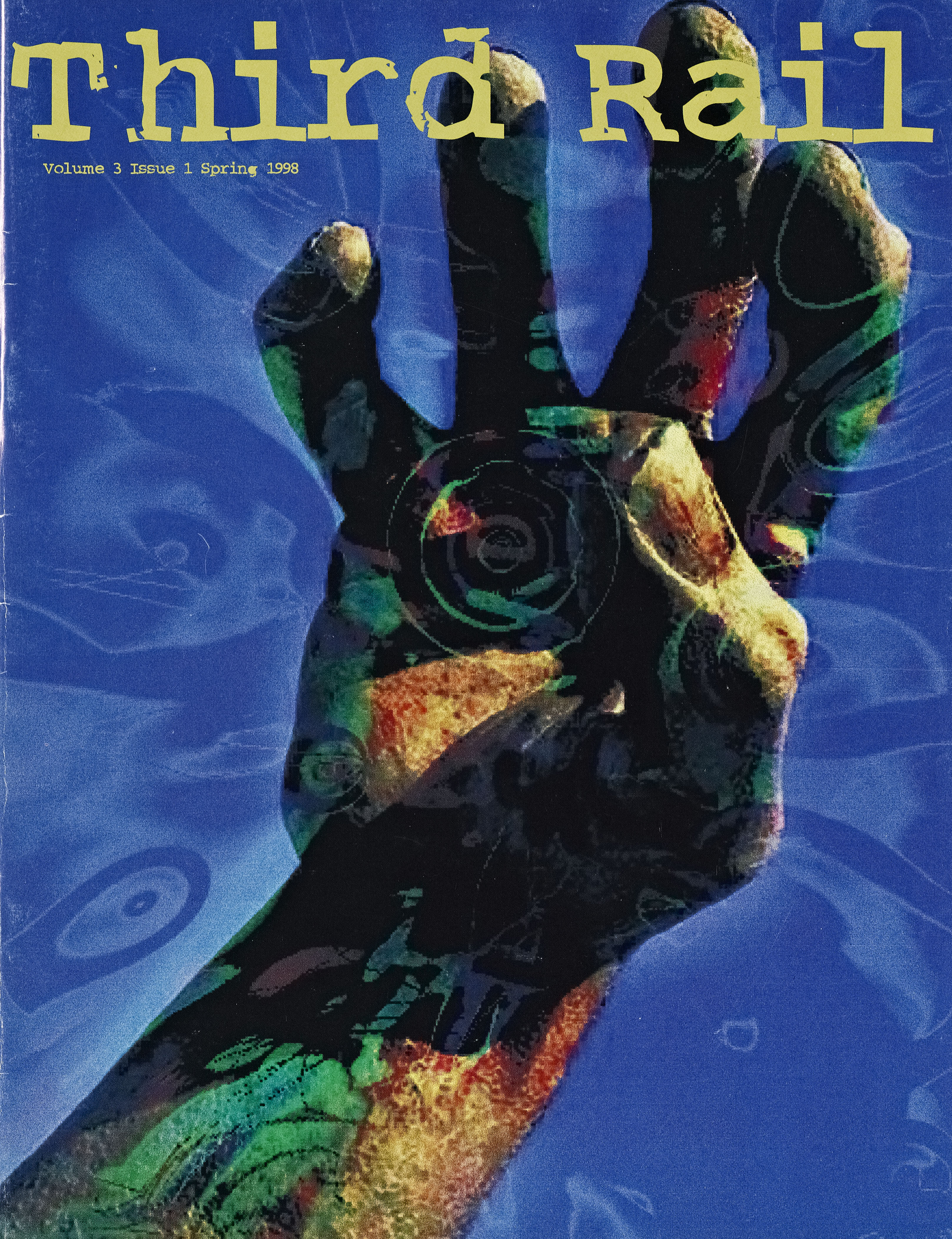 Cover of Third Rail: blue background with a drawing of a grasping hand