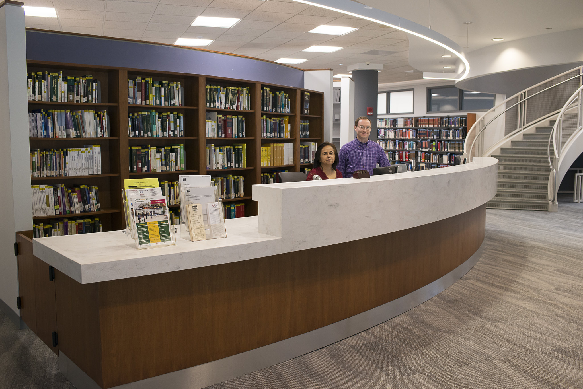 Library circulation desk with students presnt