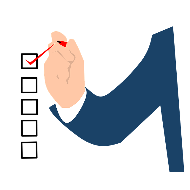 An arm with a red pen checking items off a checklist