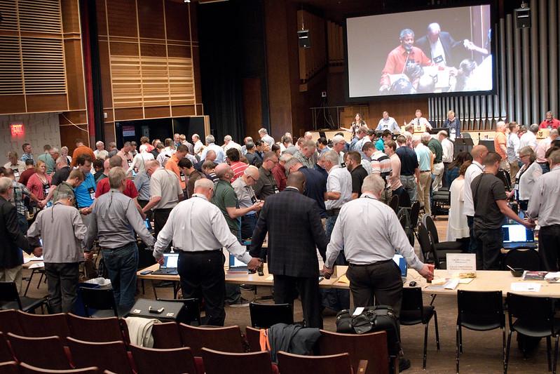 Men and Women praying at synod