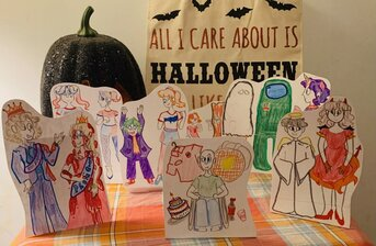 Jesse Harrell- Halloween and Our World. Drawn pop culture figures cut out against a Halloween background