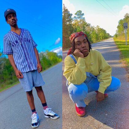 Andria Bogan- Rediscovering Our Identity. Two individuals pose in urban attire on a street.