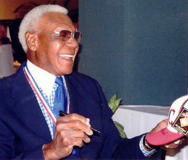 Buck O'Neil signing autographs, 2005 photograph