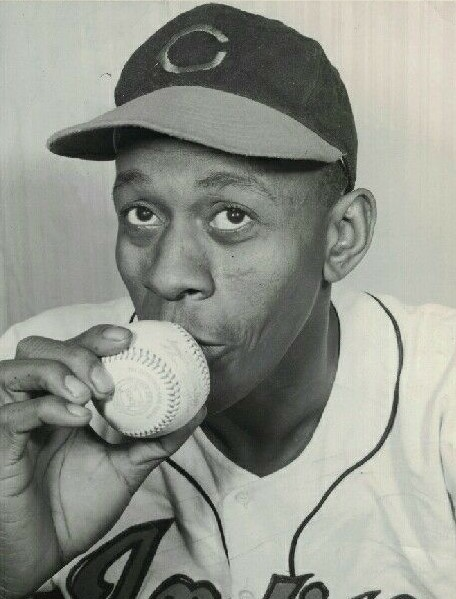 Satchel Paige kissing a baseball photograph