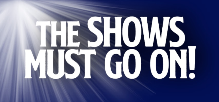 The Shows Must Go On Logo