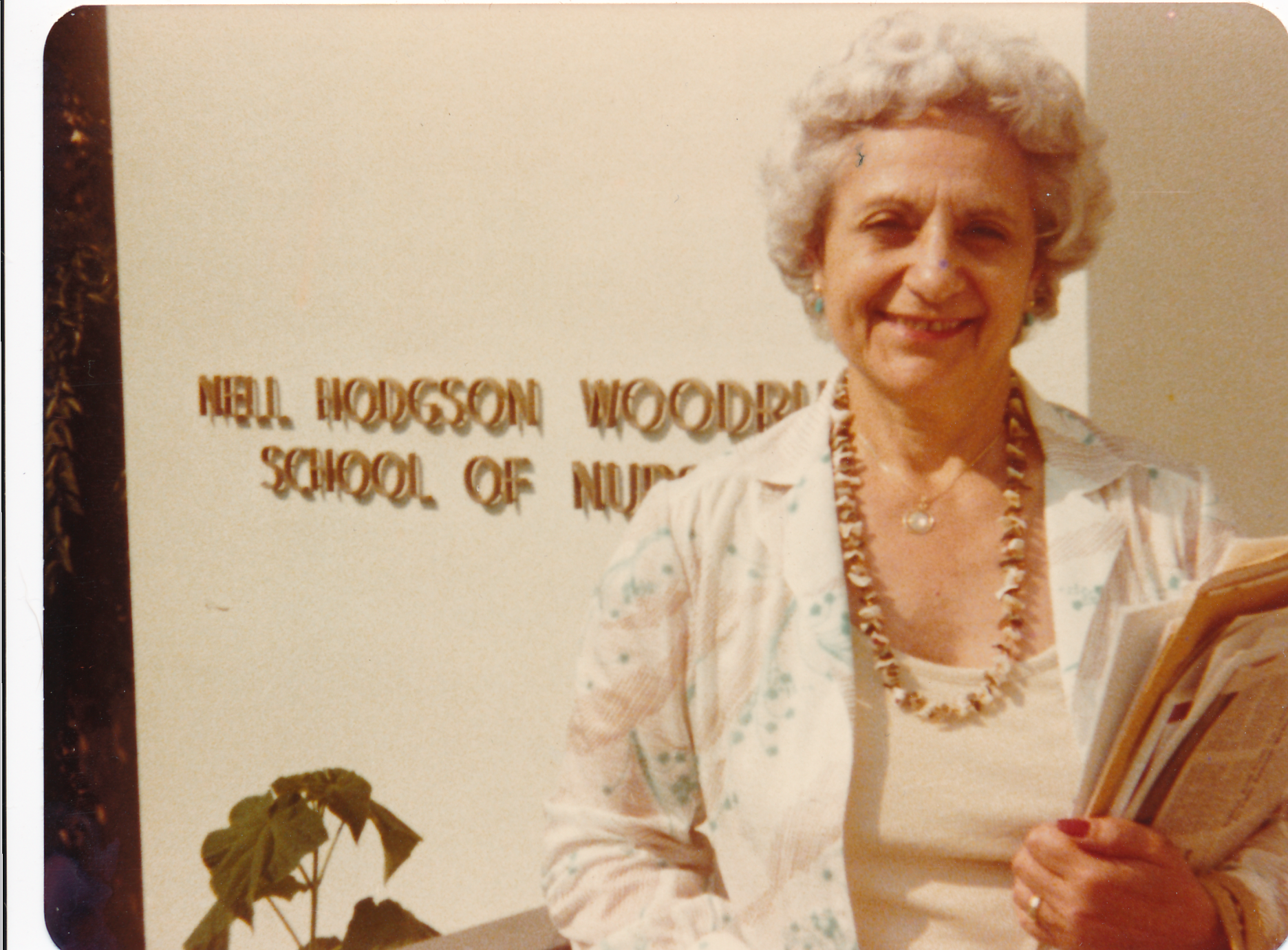 Rose Cashman Dilday standing outside of the School of Nursing building