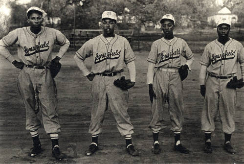 Photo of four African American baseball players