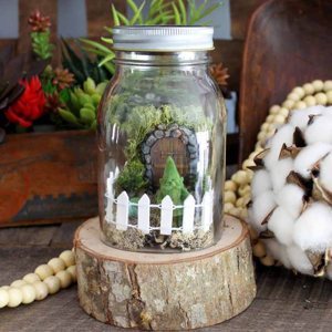 Jar with fence and door